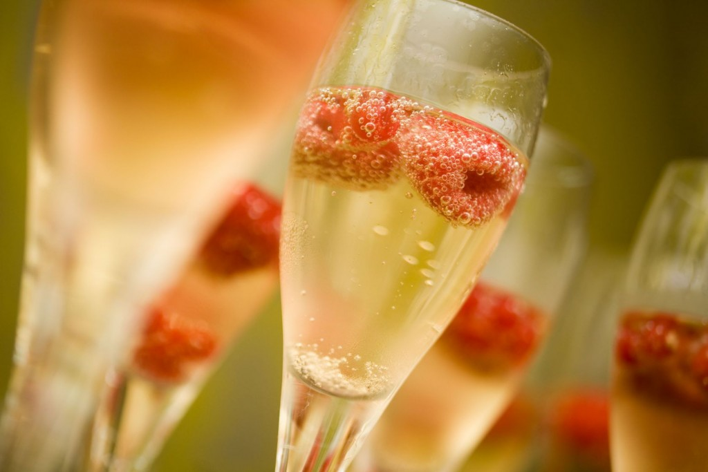 7835485 - champagne in glasses with fresh red raspberries